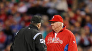 Philadelphia Phillies' Placido Polanco singles to center during 3rd-inning action against the Miami Marlins.