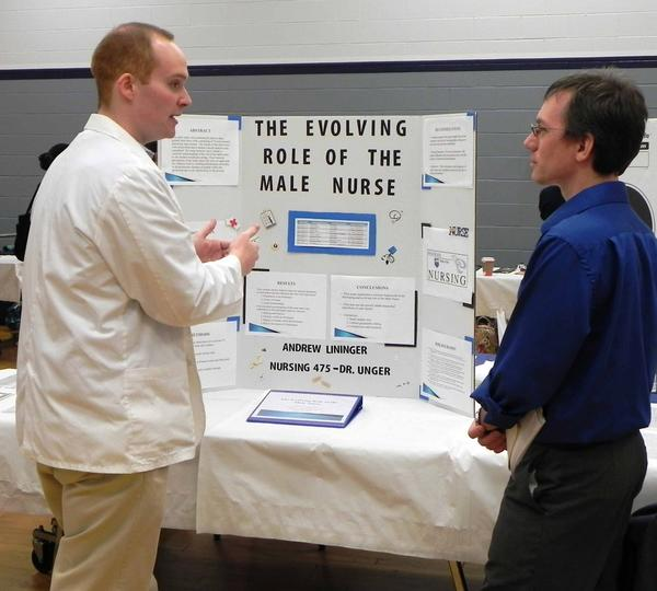 "Standing in front of his display, ""The Evolving Role of the Male Nurse,"" Andrew Lininger, of Waynesboro, Pa., was eager to answer questions about the often misunderstand profession of male nursing to English professor Peter Dendle during Penn State Mont Alto's 7th annual Academic Festival at Penn State Mont Alto on Wednesday."