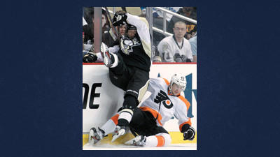 Pittsburgh Penguins' Arron Asham, left, collides with Philadelphia Flyers' Eric Wellwood (47) in the second period of Game 1 of an opening-round NHL hockey playoff series Wednesday in Pittsburgh.