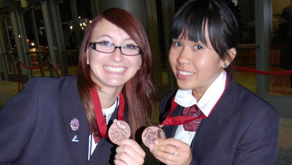 Imperial Valley College student Samantha Alvarez (left) and Joy Tango-an shown their medals at the 2012 Cal-HOSA State Leadership Conference held in Anaheim from March 29-April 1st. Alvarez won bronze in the pathophysiology competition, while Tango-an won bronze in the medical spelling competition.