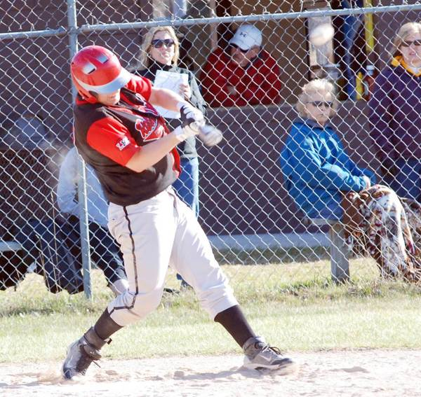 Austen Mellios of East Jordan connects for a hit Wednesday during a season-opening doubleheader Wednesday at Pellston.