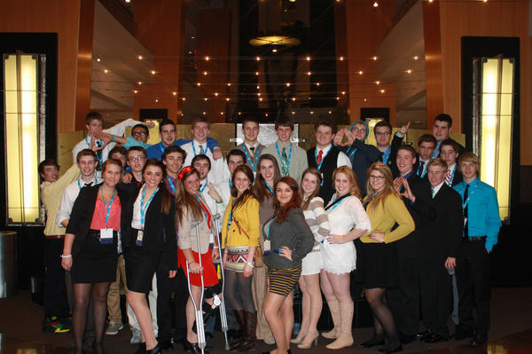 The Petoskey DECA club, a club aimed at marketing students, pose for a group shot at the state competition in March in Dearborn. Sixteen of the 30 students qualified for the international competition, which will take place the last weekend in April in Salt Lake City.