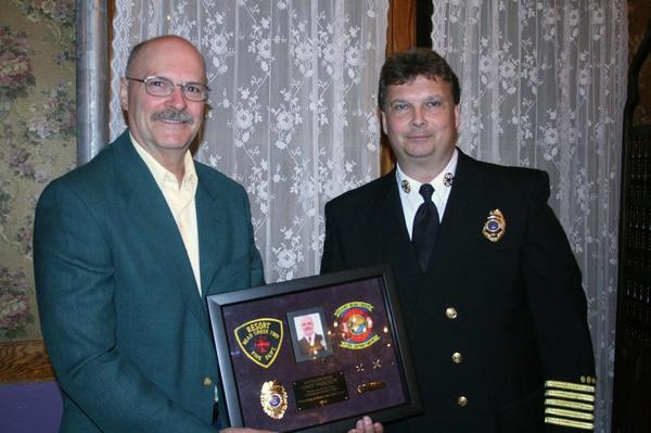 "Chester ""Chet"" Padgett (left) poses for a photo with Resort Bear Creek Fire Department Chief Al Welsheimer."