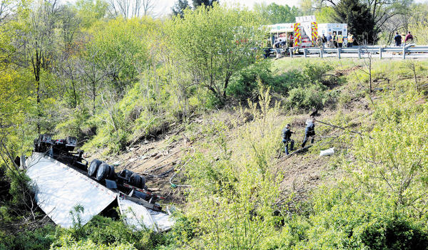 A tractor-trailer rig tumbled down a 50-foot embankment after veering off eastbound Interstate 70 at Exit 29 (Md. 65/Sharpsburg Pike) on Thursday morning. Its two occupants were airlifted from the scene.