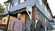 Dave Lichty and Rob Frisch, co-owners of Mt. Washington Tavern, outside their bar/restaurant after a fire last November