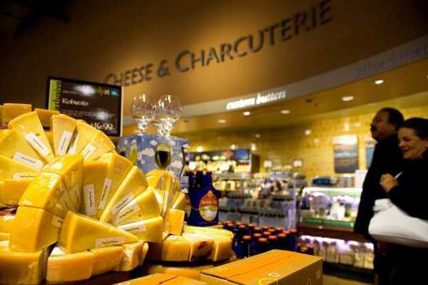 "Shoppers browse the ""Cheese and Charcuterie"" section of Whole Foods Market in El Segundo. Cheese and meats were more expensive in the first quarter of 2012."