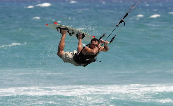A kite boarder takes advantage of the breeze off Boca Raton. Expect gusty winds over the weekend.