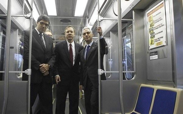 Marc Boucher, from left, Bombardier vice president of operations; CTA President Forrest Claypool; and Mayor Rahm Emanuel check out a new rail car in November. The cars were later taken out of service because of defects.