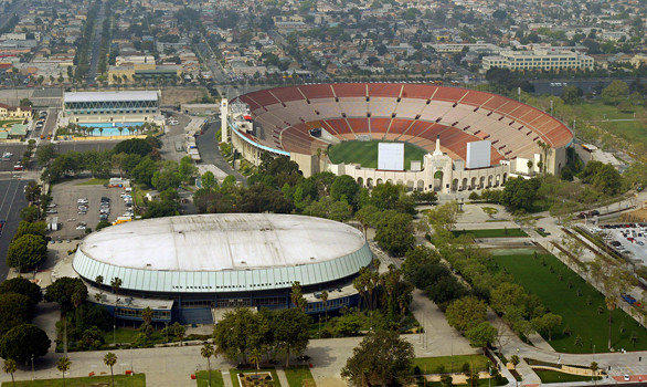The Coliseum Commission manages the Sports Arena, foreground, and the Los Angeles Memorial Coliseum.