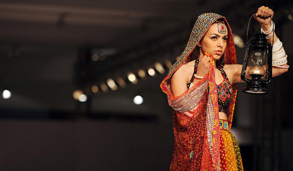 A model presents a creation by Gift University on Wednesday, the first day of Islamabad Fashion Week.