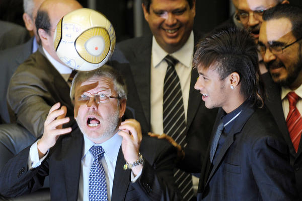 Marco Maia (left), president of Brazil's Lower House, heads a ball as Santos soccer player Neymar watches during a special Congress session Wednesday to celebrate the club's 100th anniversary.