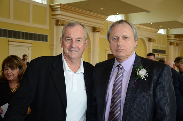 University of Connecticut men's basketball coach Jim Calhoun and Central Connecticut State University coach Howie Dickenman.