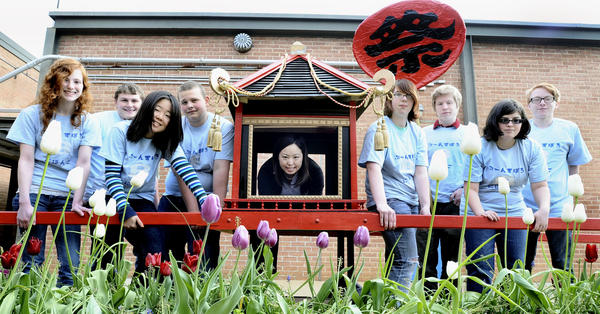 Boonsboro High students, from left, Randi Stavrou, Grant Kane, Yukiko Shinoda, Donavan Taylor, Japanese teacher Ayako Shiga, Cori Robertson, Kevin Reese, Sam Trujillo and Jacob Nelson helped build a mikoshi that they will carry in the National Cherry Blossom Festival parade this weekend in Washington, D.C. Randi, Grant, Kevin, Sam and Jacob recently returned from a trip to Japan with their teacher.