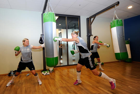 Alexandra Popp (R) boxes during a Germany training session at Fitness First club