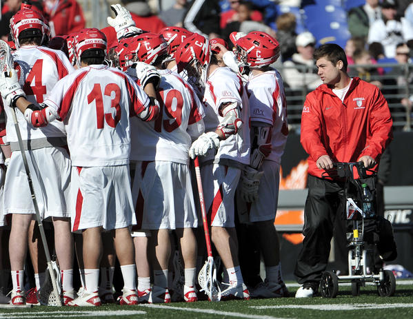 Cornell attackman Rob Pannell, right, joins his teammates during a timeout at the Face-Off Classic on March 10. Pannell has a broken bone in his left foot.