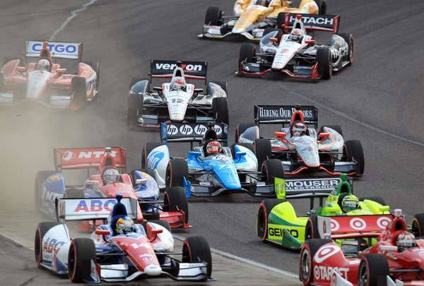 Indy Car Series drivers bunch up during an early restart during the Honda Indy Grand Prix.