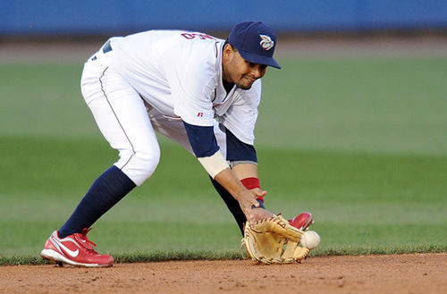 IronPigs Andres Blanco fields the ball against the Syracuse Chiefs in their baseball game at Coca-Cola park in Allentown on Thursday.