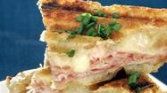OOZING FLAVOR: A croque-monsieur prepared on a panini grill combines Gruyère cheese and Black Forest ham into a sublimely golden melt.