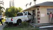 This pick-up truck hit an apartment unit along the 4100 block of Northwest 30th Terrace in Lauderdale Lakes on Thursday, April 12, 2012.