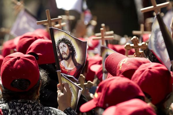 Egyptian Copts hold crosses with a picture of Jesus Christ as they take part in the Good Friday procession along the Via Dolorosa in Jerusalem's old city on April 13, 2012 ahead of Orthodox Easter.