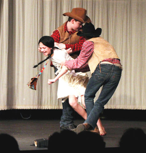 "Becca Cesario (from left) of Concord Petoskey's seventh/eighth grade drama class, plays a young Native American girl being kidnapped by government agents Cayne Davis and Luke Petersen in Thursday's production of ""The Rememberer"" at the Crooked Tree Arts Center in Petoskey."