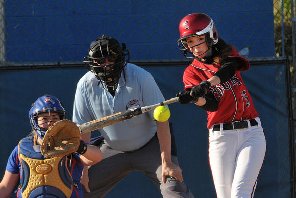 Clark outfielder Sydney Anderson makes contact with the ball during the Lady Cardinals¿ 3-2 loss to Montgomery County Thursday afternoon in Mount Sterling.