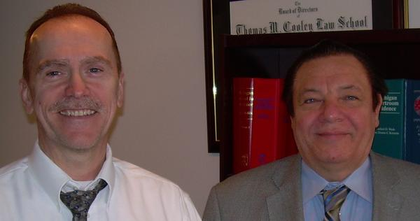 Attorneys Robert Mendham (left) and Eddie Spencer have moved their practices to a shared location in downtown Petoskey.