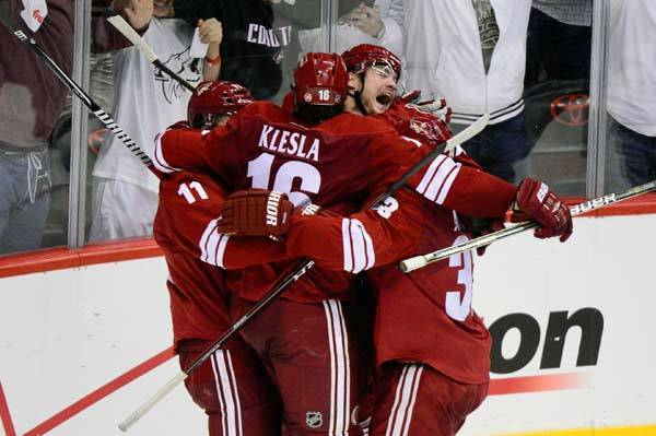 Phoenix Coyotes center Martin Hanzal (center) is swarmed by teammates in celebration after scoring the winning goal in overtime to beat the Chicago Blackhawks 3-2 in game one of the 2012 Western Conference quarterfinals at Jobing.com Arena.