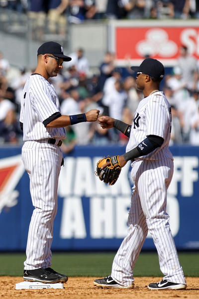 Yankees Derek Jeter, left, and Robinson Cano celebrate a 5-0 home-opening win over the Angels on Friday at Yankee Stadium.