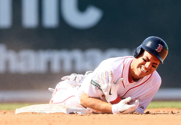 Red Sox center fielder Jacoby Ellsbury grabs his shoulder after injuring it sliding into second base on Friday.