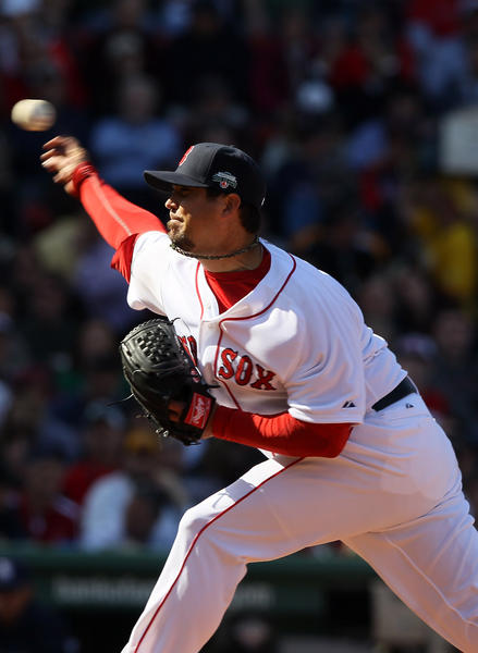 Red Sox starter Josh Beckett delivers a pitch during Boston's home-opening game Friday at Fenway Park vs. the Rays.