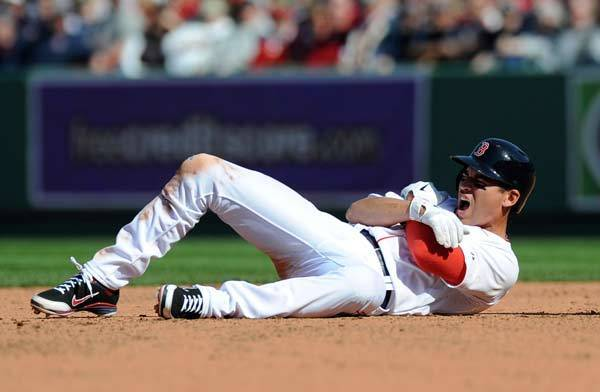 Boston Red Sox center fielder Jacoby Ellsbury (2) reacts after sliding into second base during the fourth inning against the Tampa Bay Rays at Fenway Park.