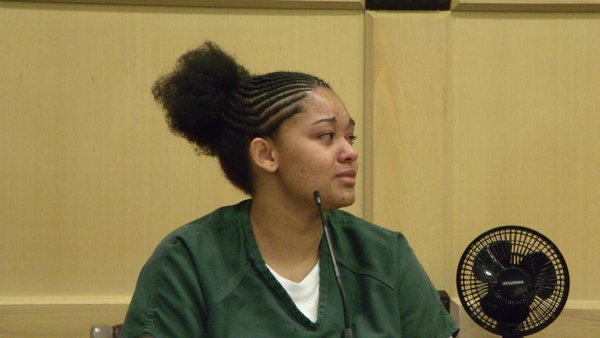 Keisha Jackson, 22, who pleaded guilty to aggravated child abuse and child neglect, asks a Broward judge for mercy during a sentencing hearing Friday. Judge Andrew Siegel gave her a 25-year prison term.