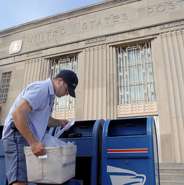 In this file photo, Postal worker Robert Mattson makes the final pickup of mail at the blue dropboxes outside the Franklin Street office of the United States Postal Service in Hagerstown.