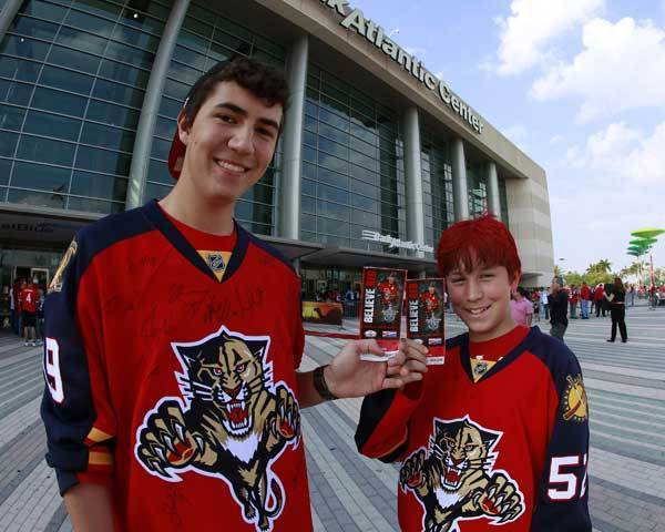 (L - R) Matt Tomlinson and Luke Tomlinson hold their playoff tickets for Game One of the Eastern Conference Quarterfinals of the 2012 NHL Stanley Cup Playoffs before entering to see the Florida Panthers play the New Jersey Devils at the BankAtlantic Center on April 13, 2012  in Sunrise, Florida.
