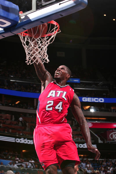 Atlanta forward Marvin Williams (24) dunks during the fourth quarter of the Hawks' 109-81 victory over the Orlando Magic in Orlando, Fla. Friday, April 13, 2012.
