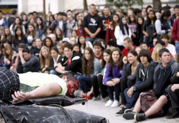 La Canada High School student Connor Boyd acts dead during the anti-drunk driving program Every 15 Minutes, staged in front of the school in La Canada Flintridge on Thursday. Actual first responders like the local L.A. County Fire Department, L.A. County Sheriff, L.A. County Coroner, and California Highway Patrol officers responded to the scene.