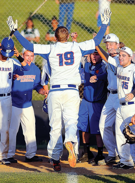 Boonsboro's Brian Cibula (19) is greeted at home plate by his teammates after slugging the game-winning grand slam in the seventh inning against South Hagerstown in Friday's MVAL Antietam baseball game.