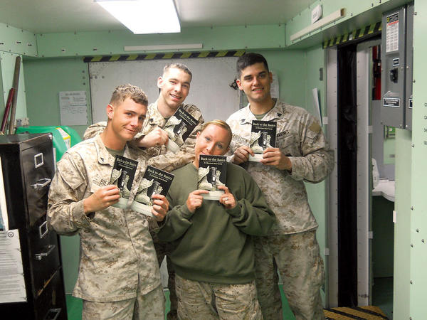 "Marine Chris Anderson and his fellow soldiers hold copies of his new book, ""Back to Basics,"" about the fundamentals of Christian faith."