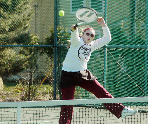 Steve Zucker/Charlevoix Courier Charlevoix's Kelsea Stevens sends a hard shot for a point in her No. 1 doubles match with partner Emily Roloff against Grayling Wednesday, April 11, 2012