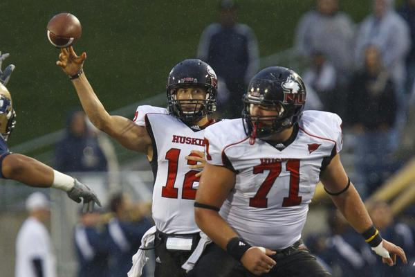 Northern Illinois quarterback Chandler Harnish passes the ball as center Scott Wedige blocks during the first half against Akron.