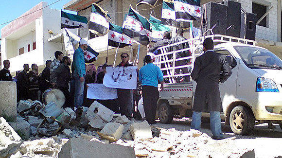 People in Qusair take part in a protest against Syrian President Bashar Assad.