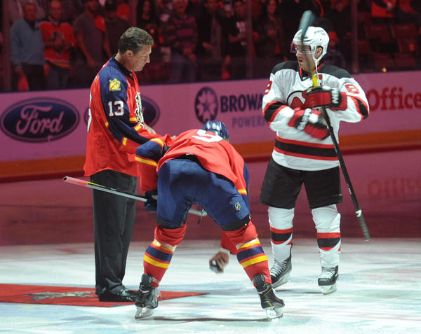 Dan Marino drops the ceremonial puck before the start of Game 1 against the Devils. New Jersey Devils vs. Florida Panthers Round 1 NHL Playoffs. BankAtlantic Center, Sunrise, Florida. 4/13/12. Jim Rassol, Sun Sentinel.