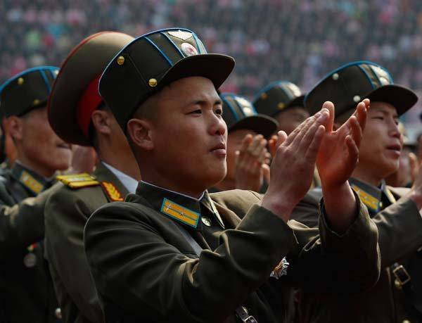 Soldiers applaud North Korea leader Kim Jong-un during a ceremony at a stadium in Pyongyang.
