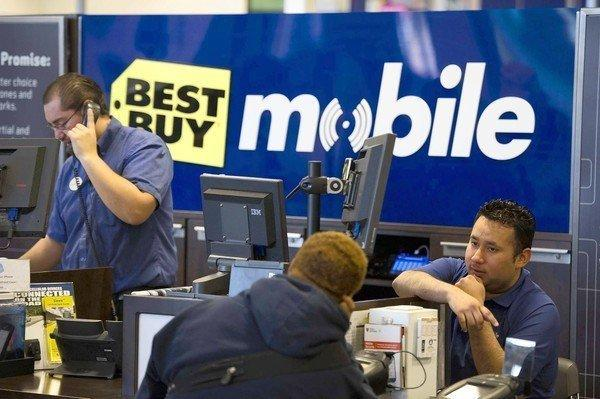Employees help customers at a Best Buy store in Emeryville, Calif.