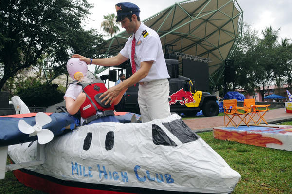 Jake London of the Mile High Club, seats his flight attendant in the team craft before the start  of  the second annual  Red Bull Candola on the New River in downtown Fort Lauderdale Saturday.