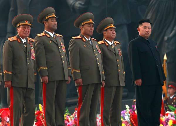 Kim Jong-un stands with military officers during the unveiling ceremony of bronze statues of North Korea founder Kim Il-sung and late leader Kim Jong-il in Pyongyang.