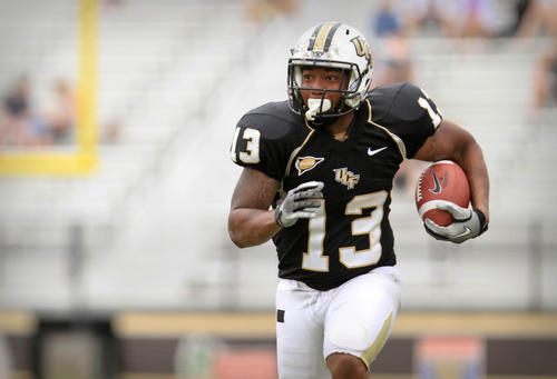 UCF HB Dontravius Floyd (13) runs the ball for yardage during fourth quarter action of a UCF Spring Football game at the Brighthouse Networks Stadium on Saturday, April 14, 2012 in Orlando, Fla.