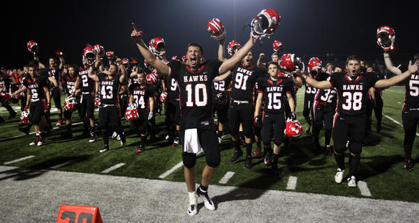 Maine South's Matt Alviti (10) celebrates with his team after beating Wheaton Warrenville South.