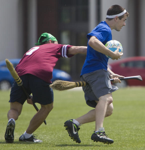 Christopher Newport's Curran Henry gets past Kutztown's James Roach during a Quidditch match at CNU on Saturday, April 14.